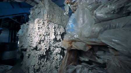 collected : Pressed pile of garbage and polyethylene stocked in a factory facility ready for recycle. Stock Footage