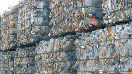 collected : Multiple blocks of plastic trash storaged outdoors. Recycling concept.