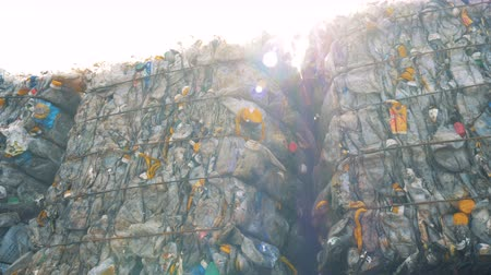 collected : Blocks of junk plastic bottles storaged outdoors. Waste recycling concept.
