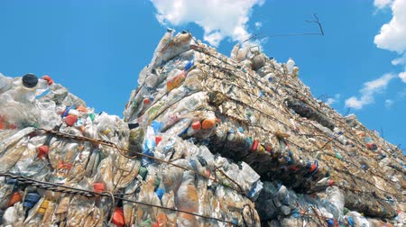 preslenmiş : Used plastic bottles storaged in pressed blocks outdoors ready for recycling. Waste recycling concept.