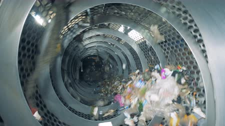 harmful : Garbage recycling machine during working process. Garbage sorting plant.