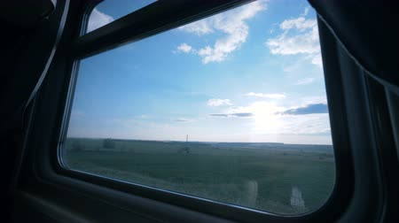 přihrádka : View of a vast field from a window, close up.
