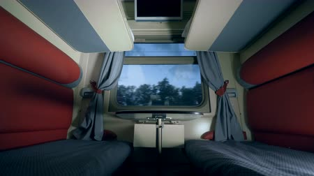 двухместная карета : Two seats and a table in a train coupe. Travelling by train concept.