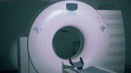 tomograph : A white scanner in an empty room, close up.