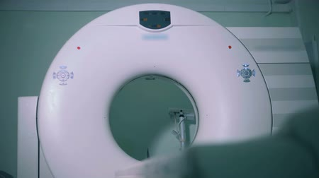 tomograph : Big scanning device at a clinic, close up. Special tomograph works in an empty room.