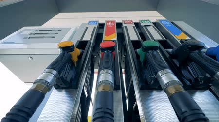 filling station : Colorful nozzles at a station, bottom view. Stock Footage