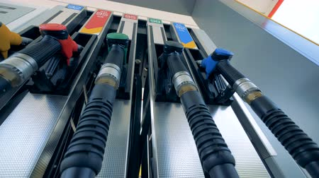 literário : Petrol nozzles on a tank at a station. 4K. Stock Footage