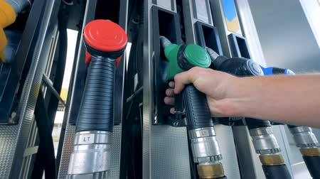 filling station : Man places a nozzle on a tank at a modern gas station. Stock Footage