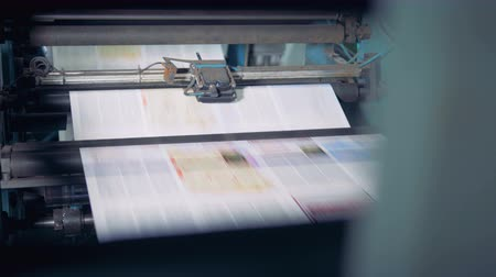 sheet : Newspaper printed on a printing house machine. 4K. Stock Footage