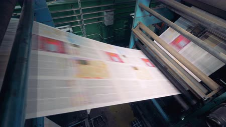 ofset : Newspaper printing at a plant, close up. Newspaper printed on a printing house machine. Dostupné videozáznamy