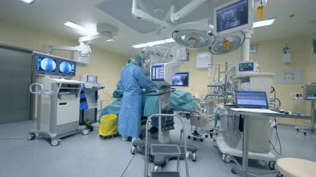 surgical mask : Big room with surgical equipment.