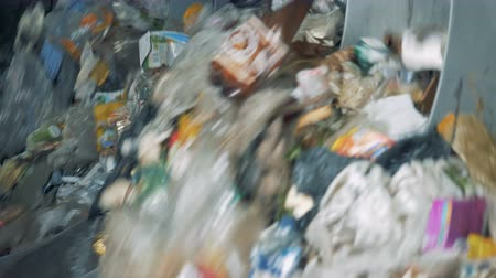 reciclado : Waste prepared for recycling in a garbage sorting center.
