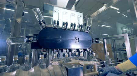 verifying : Bottles on a special conveyor, close up. Automatic factory equipment.