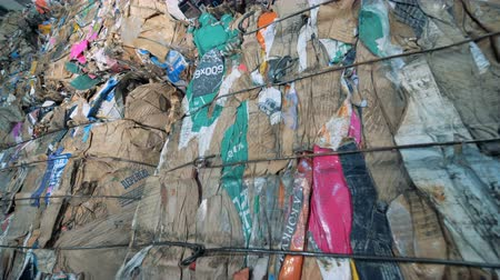 compressed : Long stacks of garbage, close up. Pressed plastic trash is at a recycling factory. Stock Footage