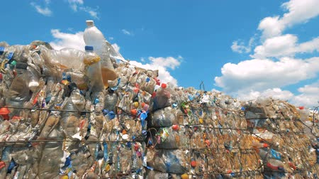 preslenmiş : Piles of plastic trash on a sky background, close up.