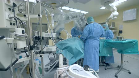 intensive care unit : A group of surgeons is performing an operation in a medical unit Stock Footage