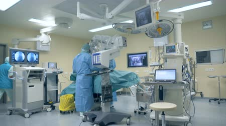 equipped : Surgical procedure is being performed in a fully-equipped medical room Stock Footage