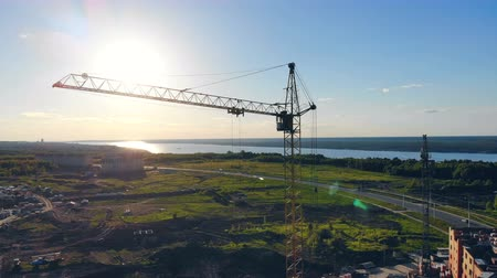 built up : Construction crane near road. Aerial shot.