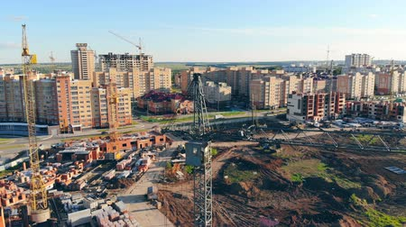outskirts : Modern construction site with lots of equipment. Aeria view.