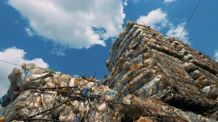 compressed : View of a landfill on a sky background. Rubbish in huge stacks lay on a dump.