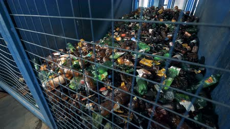 sorted : Many plastic bottles in a container, close up.