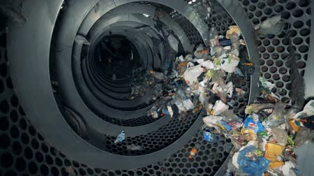 industrialization : Recycling process at a plant. Rotating machine recycles trash in a waste center. Stock Footage