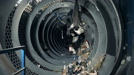 discard : Lots of household waste being sorted in a machine for recycling. Stock Footage