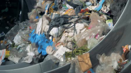 sorted : Lots of household trash is sorted for recycling at a plant. 4K.
