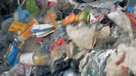 extrusion : Discarded garbage at a recycling factory, close up.