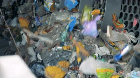 sorted : A machine works in a sorting center. Used garbage is sorted at a factory for recycling and waste disposal.