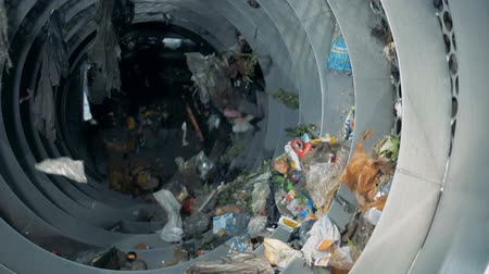 wasted : Process of waste disposing at a factory, slow motion.