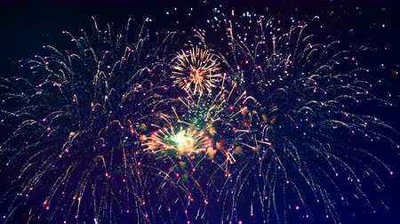 firecrackers : Bright flashes of fireworks are illuminating the dark sky. Happy new year concept.