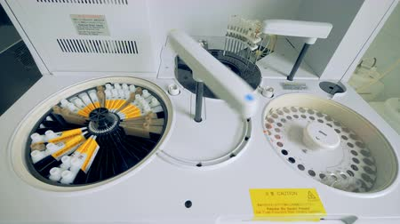 vérplazma : A medical centrifuge with two sections, close up. Stock mozgókép