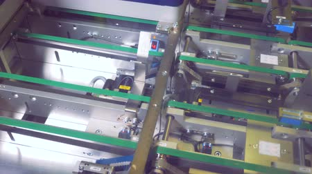 producing energy : Top view of solar module cells moving along two rows of conveyor belt. Green energy concept.
