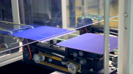 producing energy : Solar module cells are moving along the conveyor belt one by one. Innovative production concept. Stock Footage