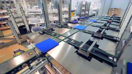 producing energy : Factory facility with solar module cells being moved along the conveyor belt - Innovation technology concept.