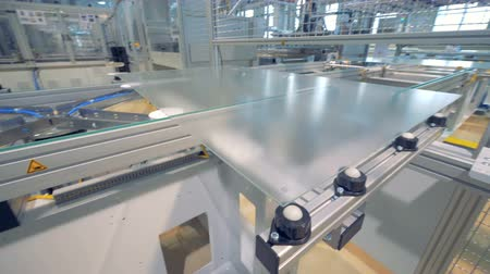 producing energy : Plastic plate is moving along the machine in a factory unit - modern automated production concept.