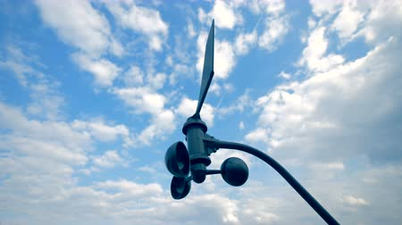 barometr : weather forecast concept. Wind turbine is slowly rotating in the open air.