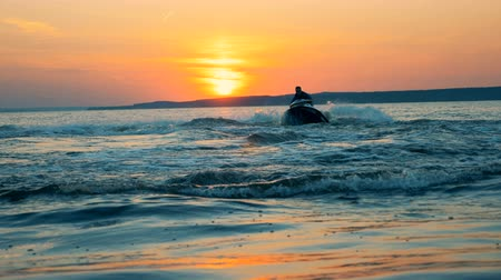 jet ski : A person doing slide slips on a jet ski. Stock Footage