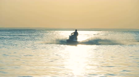 robogó : Male rider on a waverunner, close up.