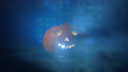 questão : Scary pumpkin with blue lights on it, close up.