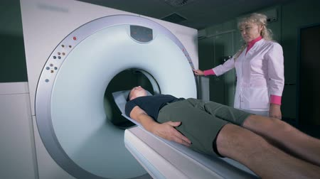 tomograph : Tomographic scanning on a patient, close up.