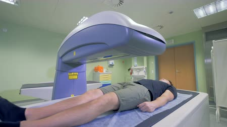 tomograph : Tomographic machine scans a patient, close up. Stock Footage
