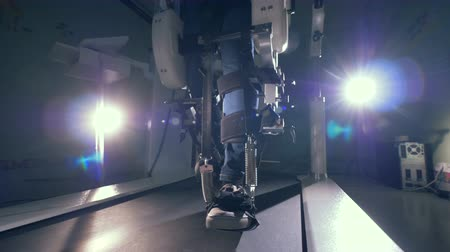 challenged : Walking simulation machine during training process of persons legs. Innovative robotic VR cybernetic system.