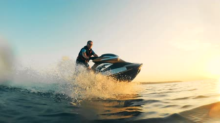pwc : Jet-skiing process of a waterbike with a man managing it