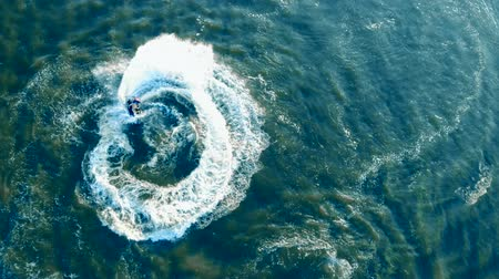 pwc : Spiraling movements of a watercraft in a view from above