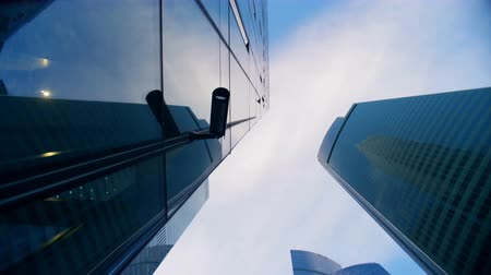 red centre : Security camera and reflective walls of towering building from a bottom view Stock Footage