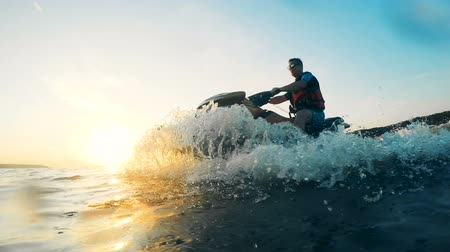 jet ski : Splashes formed by a jet ski driven by a rider.