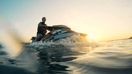 jet ski : Sunset lake with a man jet-skiing. Waverunner riding. Stock Footage