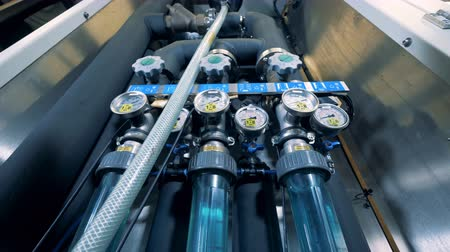 panele : Modern water purification equipment. Valves, gauges at a water quality control panel.
